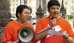 Mary Ward students, Joshua and Jerome Lieu speak at a Make Poverty History campaign rally on Parliament Hill, Ottawa