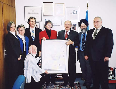 Presenting a framed Golden Rule Poster to the Secretariat of the United Nations on January 4, 2002 were leaders from the North American Interfaith Network (NAIN) and some of its member organizations and friends: Rev. Deborah Moldow from United Religions Initiative at the UN and World Peace Prayer Society; Sister Joan Kirby, Representative to the UN from Temple of Understanding; Father Terrence Gallagher, from Scarboro Missions in Toronto; Joel Beversluis, Editor of the NAIN newsletter and CoNexus Multifaith Media; Mrs. Gillian Sorensen, Assistant Secretary-General of the United Nations for External Affairs; Jonathan Granoff, from Temple of Understanding, Bawa Muhaiyadeen Fellowship, and Global Security Institute; Ralph Singh, Secretary of the NAIN Board, from Gobind Sadan-USA; and Dr. Elias Mallon, a founder of NAIN and Dean of Auburn Seminary.