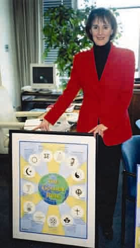 Gillian Sorensen, Assistant Secretary-General of the UN, accepts the Golden Rule Poster