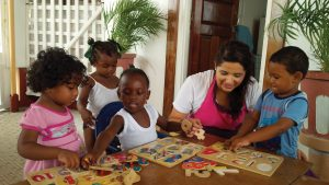 Paulina Gallego with some of the children at the daycare where she worked in Georgetown, Guyana.