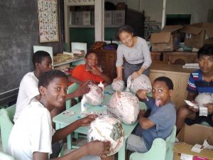 Scarboro lay missioner Donna Tai making papier mâché piñatas with students at the St. John Bosco Academy, a school for orphaned boys in Georgetown, Guyana. Donna's ministries include the orphanage, catechesis, and bringing music and friendship to the elderly and shut-ins. She hopes to begin working with victims of human trafficking, an initiative of the Sisters of Mercy.