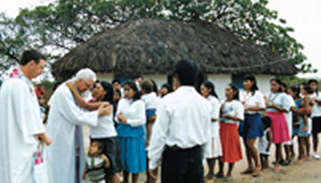 L-R: Scarboro missioner Fr. Ron MacDonnell and Bishop Aldo Mongiano greet villagers who are about to receive the Sacrament of Confirmation in the Makushi Indigenous community of Guariba, Roraima Diocese, Brazil.