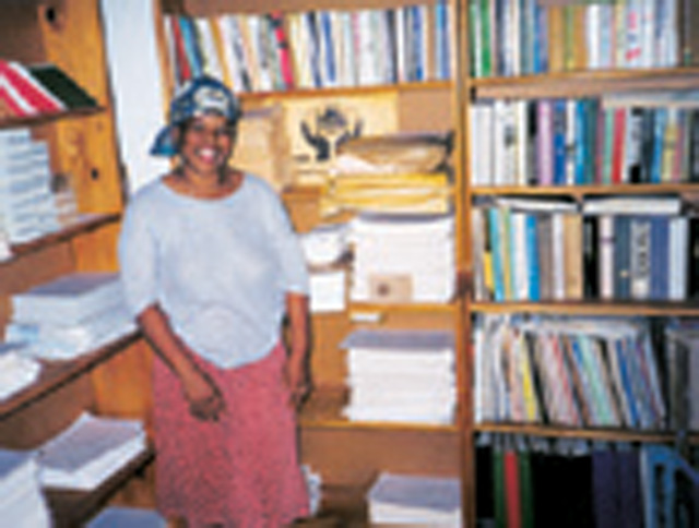 Mrs. Magubane in the offices of the credit union established by Scarboro missionary, Fr. Jack McIver in Eshowe Diocese, South Africa. Mrs. Magubane was Fr. McIver's assistant and still manages the centre today.