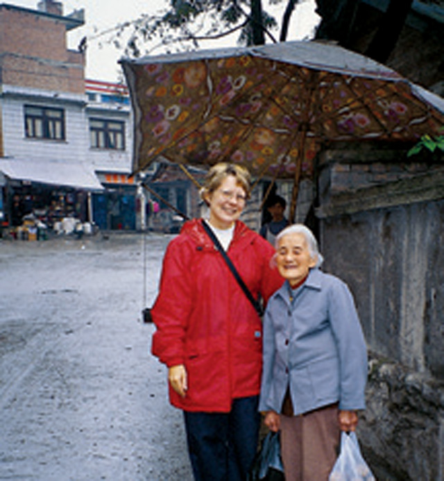Scarboro lay  missioner Mary Lou Howard with a Chinese neighbour on market day. Guizhou Province, China.