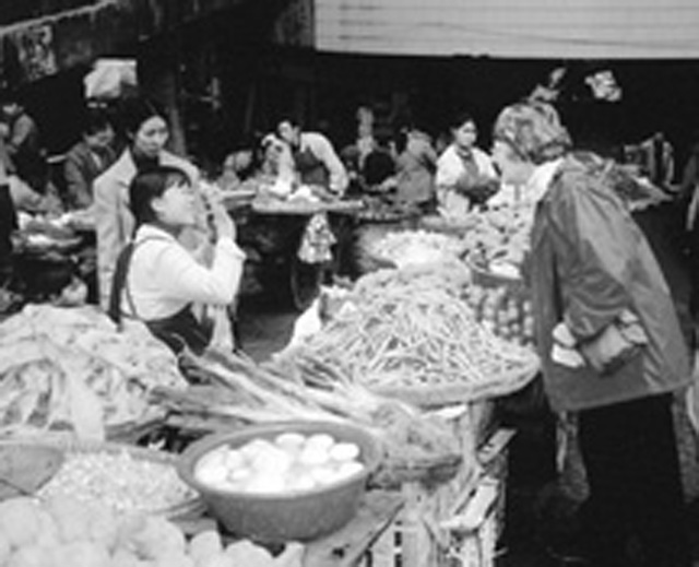 (CREDIT: Beverley Vantomme) China missioner Mary Lou Hoawrd at the market near her apartment.