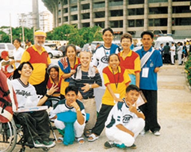 Scarboro missioners Paddy Phelan (far left, with yellow cap) his wife Georgina (second from right) and Scott McDonald (centre) with students from the Redemptorist School for the Disabled where they teach. The students were participating at an athletic competition. Pattaya, Thailand.