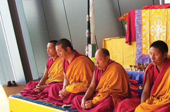 Buddhist monks perform an opening chant before a workshop.