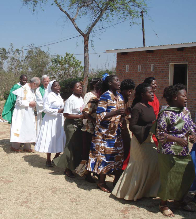 (Credit: Scarboro Missions) During a visit to Scarboro's mission team in Mzuzu, Malawi, Fr. Jack Lynch concelebrates Mass, with the women leading the opening procession.