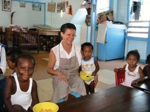 Former Scarboro missioner Estrela De Sousa with orphaned children in Guyana.
