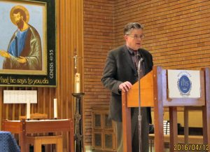 As the evening's moderator, Fr. Scott Lewis, VP and Dean at Regis College introduces the two speakers