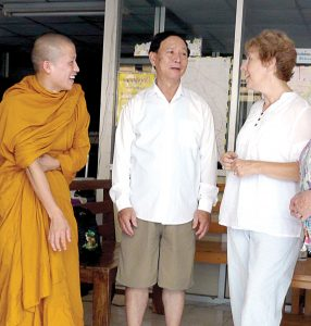 Former Scarboro lay missioner Susan Keays with Mr. Hsai, director of the Migrant Centre where Susan taught, and a Buddhist monk studying at the Centre. Thailand. 2010