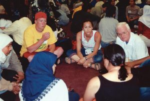Fr. Dave Warren at a World Youth Day 2002 (Toronto) event initiated by the Toronto Muslim community and co-sponsored by Scarboro Missions Interfaith Department. The event brought together 200 Muslim and 200 Catholic youth for an evening of dialogue.