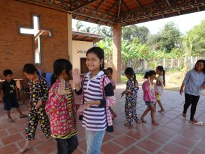 Children in the small Catholic community of Kdol Leu performing a Khmer dance. Cambodia