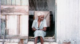 Evangeline outside her humble home in a batey. Dominican Republic.